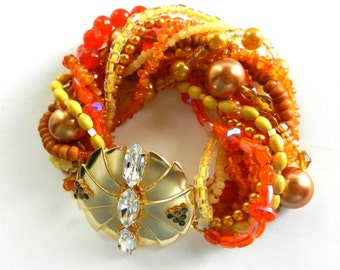 Beautiful 1970s Venetian 12 strands Torsade  bracelet-color & brilliance in a palette of orange,tangerine, yellow- dazzling Clasp-Art.974/3