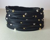 Black Leather slitted cuff bracelet with metal beads