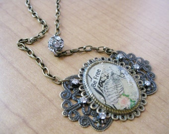 Be Free Anatomy Cameo Necklace made with Music Sheet from the early 1900's and Sterling Silver German Glass Glitter