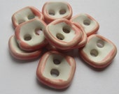 White and pink square ceramic buttons