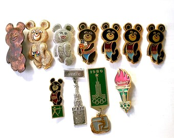 1980 Moscow Olympics Set of 11 Badges Pins Bear Mascot Misha Torch Flame Communist Sports Propaganda Memorabilia from Russia Soviet Union