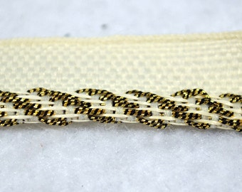 Fifteen yards of Wrights Gold and Cream braided upholstery or drapery trim