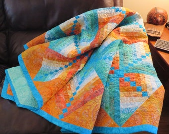 Fire and Ice modern quilted tablecloth couch throw batik turquoise aqua orange blue