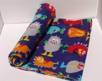 Lightweight fleece baby blanket - friendly monsters