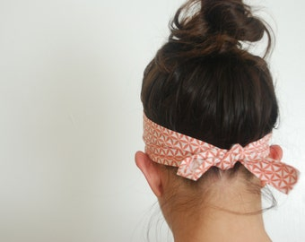 Nice and Wide Tie Headband in Coral Geometric