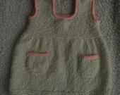 Dress/tunic/pinafore/sweater for a baby girl, hand knitted in cream boucle yarn, 20 ins chest, age approx 9-12 months