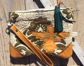 Oversized Wristlet in vintage rustic floral remnant, leather thunderbird, hand-stitched mint arrow, teal tassel & detatchable wristlet strap