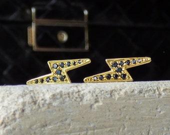 Strike Fairtrade Gold Lightening Strike Stud Earrings in 18k with Black Diamonds.