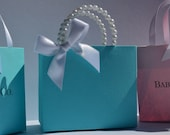Blue party favor bags for your baby shower with pearl handles