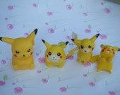 Set of 4 Pokemon Figures. All Pikachu. Each Different. First Generation.