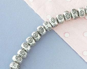 20 of Karen Hill Tribe Silver Daisy Imprint Beads 5x3.5 mm. :ka4140