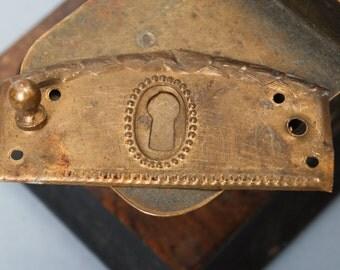 Antique brass key hole escutcheon