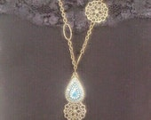 Exotic Brass Opera Length Necklace with Vintage Pendent