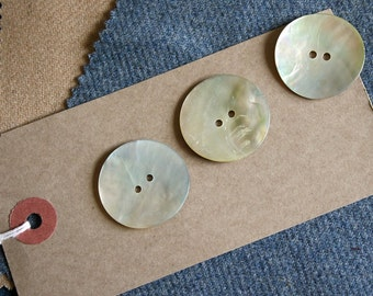 Pretty vintage shell buttons with a pearly finish