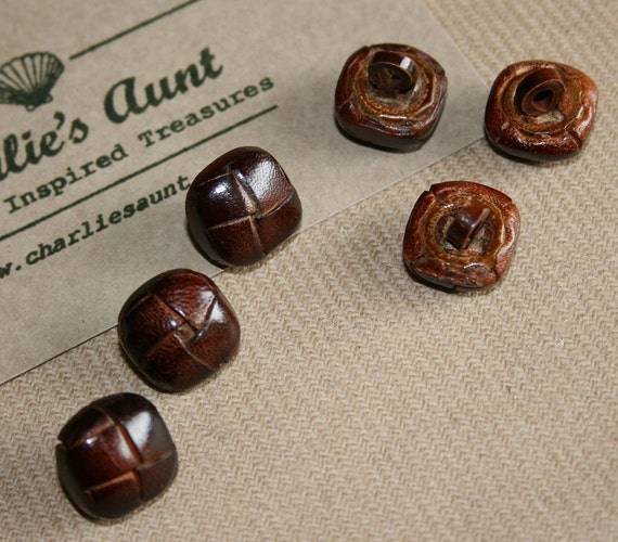 SIX tiny vintage leather covered buttons in a rich conker brown