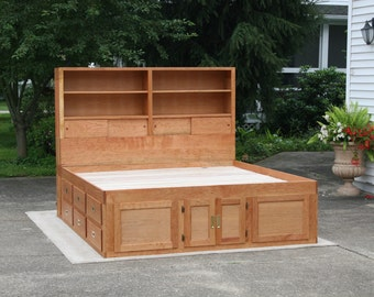 Solid hardwood platform bed with 12 drawers and storage head board with shelves, natural color