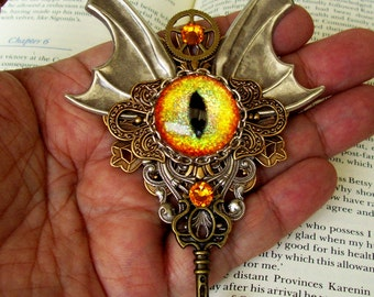 Dragon Eye Brooch (P508) - Steampunk Design - Yellow Prism Glass Eye - Brass Stamped Pieces - Swarovski Crystals