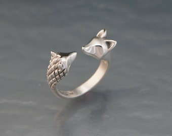 curious hedge hog / fox in  silver