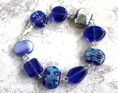 Recycled Glass Bead Bracelet. Handmade Recycled Glass Beads from a Skyy Vodka Bottle.