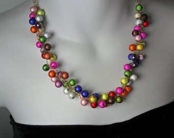 Glowing colors crocheted necklace. Mericle beads that glow.