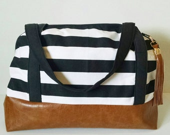 Black and white striped weekender with faux leather