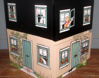 Bespoke girl's bedside drawers hand painted as a house.