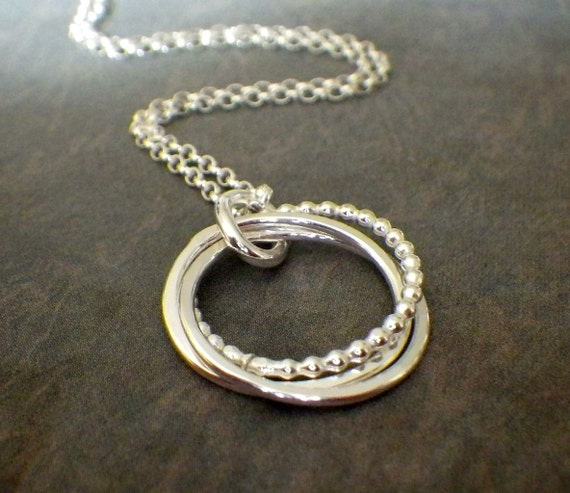 3 interlocking rings 3 4 silver beaded necklace by