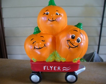 Three Pumpkin in a Wagon