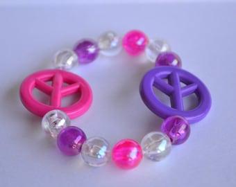 Girls pink and purple peace bracelet