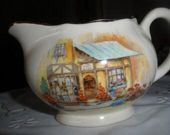 Milk jug or creamer called The Posy Shop, Hanley, made in England
