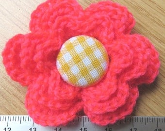 Irish crochet flower brooch in neon pink wool with gingham button centre