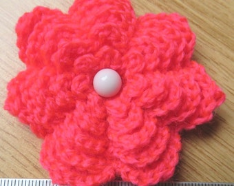 Irish crochet flower brooch in neon pink wool with glass button centre