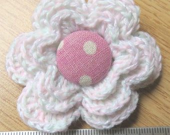 Irish crochet flower brooch in very pale pink and green wool with pink button centre