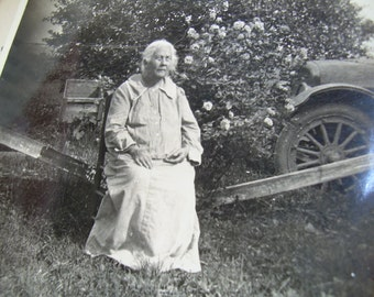 Vintage Snapshot Photo - Granny Sitting in Yard Beside Old Car