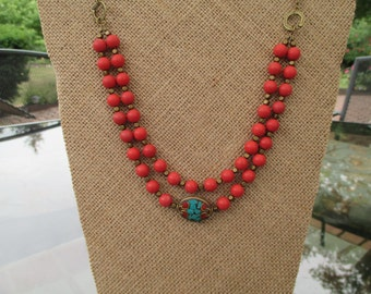 Double Strand Coral Glass Bead Necklace/ Brass and Tibetan Focal Bead