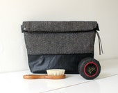 Toiletry bag, roll-up makeup bag, black and white herringbone with golden threads and faux black leather.