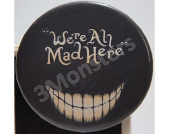 """Alice in Wonderland Chesire Cat """"We're All Mad Here"""" Pin Badge Button"""