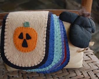 Prim sheep with seasonal felt blankets