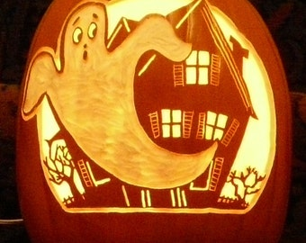 Vintage ghost scene on a hand-carved foam pumpkin for Halloween decorating