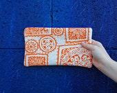 ecofriendly zipper bag, orange screenprint pouch, orange zipper pouch, tribal print bag, handmade by greenbugmarketplace