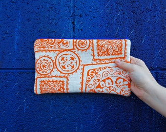 ecofriendly zipper bag, orange screenprint pouch, orange zipper pouch, tribal print bag, handmade by greenbugmarketplace