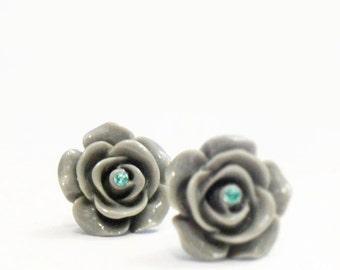gray rosette earrings with teal rhinestone