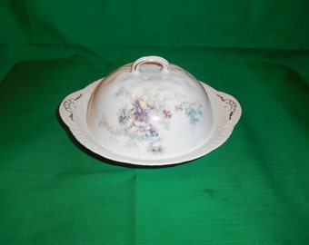 One (1), 3 Piece Butter Dish with Cover. Unmarked, with a Delicate Floral Pattern.