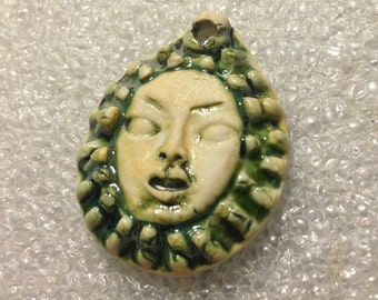 Handmade ceramic face pendant Asian influence green