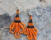Perfect for Fall or Halloween! Fun and pretty orange and black loop hand-beaded glass earrings