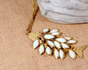 Large Gold Tone Textured Fish Penant Necklace with White Dangling Scales