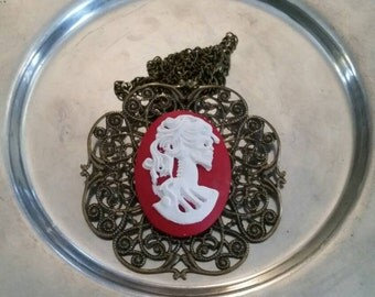 The Skeletal Lady red and white cameo on aged gold filligree pendant