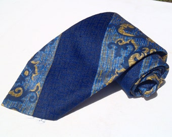 Vintage 1970s Wide Blue and Gold Polyester Tie with Ornate Diagonal Stripes