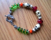 Skulls of bone Toggle Bracelet. BLOODY Red, Ghoul Green, Pumpkin Orange, Black Cat Black.