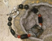 Toggle Bracelet. Black Onyx and Red/Orange Agate, Dragons Vein Quartz and Rainbow Obsidian.